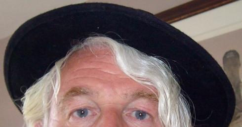 Tel in black hat cropped